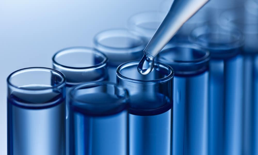 A researcher uses test tubes and an eyedropper to study a drug found on our list of SARMs.